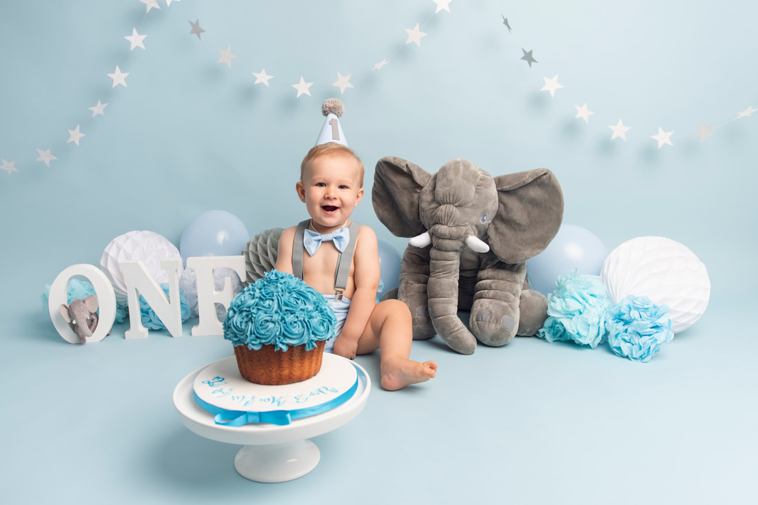 Baby boy first birthday cake smash photoshoot in Sheffield, Yorkshire.